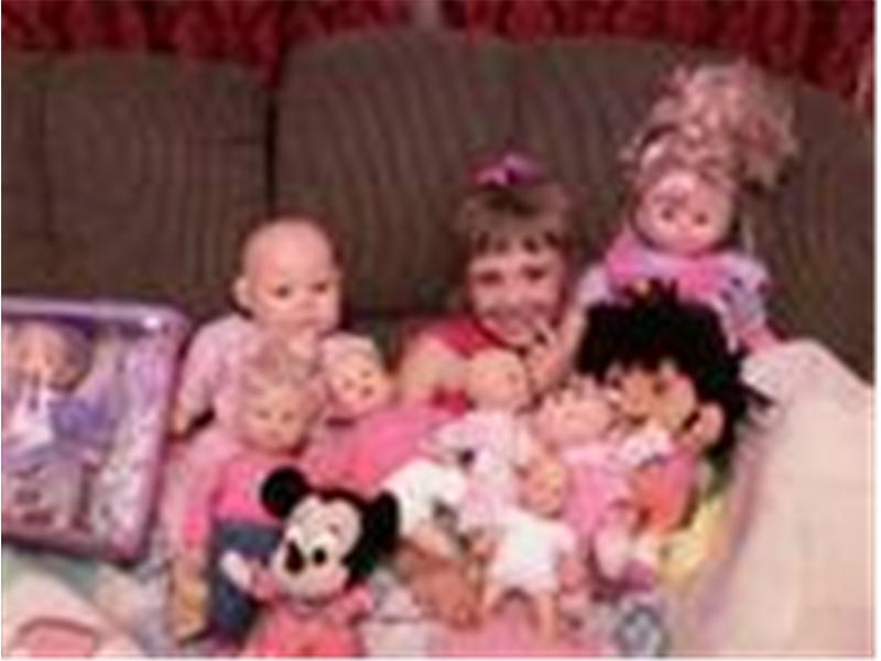 Most Baby Dolls Sitting With A Five-Year-Old Girl